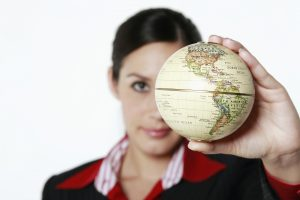 Woman Holding a Small Globe in Her Hand