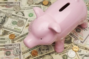 Pink Piggy Bank on Top of Money