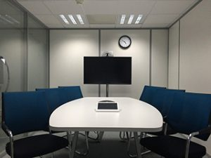 Conference room with a iPad and a TV on the wall