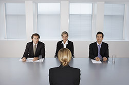 Three Employers Interviewing a candidate
