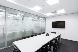 Board room with screen to have an online interview via VidCruiter
