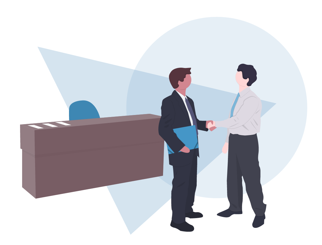 Two Men Standing Infront of a Desk Shaking Hands