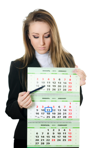 Woman Point at a Calendar